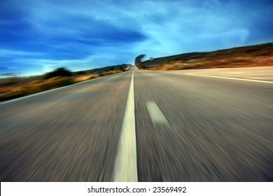 road on with a blue sky in motion
