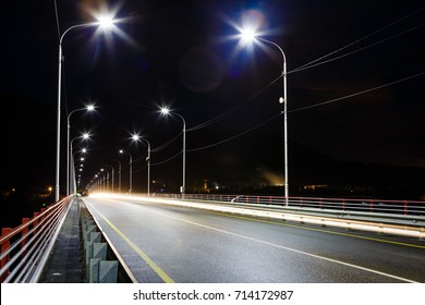 The road on the bridge with lamps, the night picture on long endurance