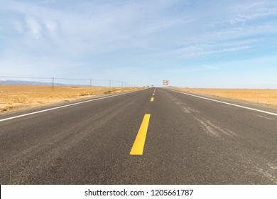 road on gobi, highway through the desolate land, xinjiang