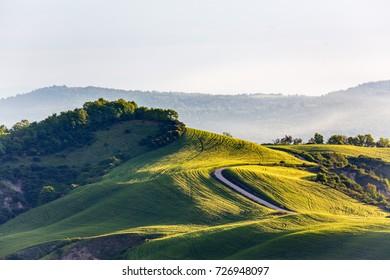 Road on a hillside in rural landscape