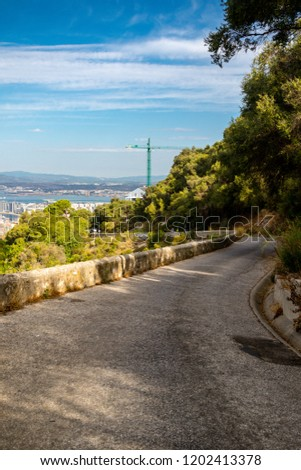 A road on the Rock of Gibraltar in the Upper Rock Nature reserve. Gibraltar is a British Overseas Territory located on the southern tip of Spain.