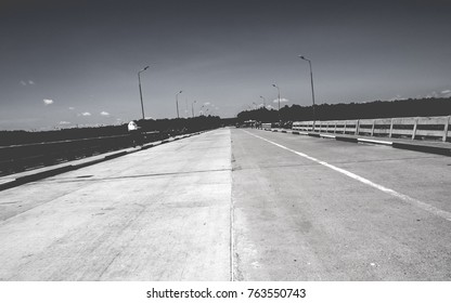 A road on the vintage bridge background wallpaper in monotone with free copy space.
