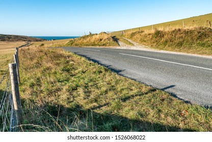 Road over the South Downs to Birling Gap. The road over the South Downs (East Sussex, England) leading to the English Channel coastline and Birling Gap.