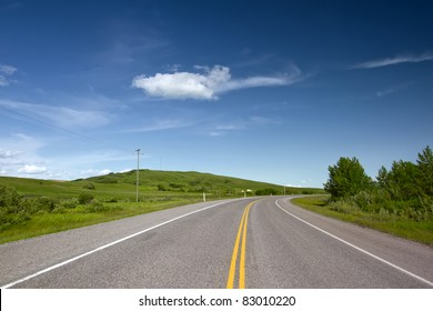 Road With Painted Double Yellow Line. Photo is taken in Alberta, Canada.