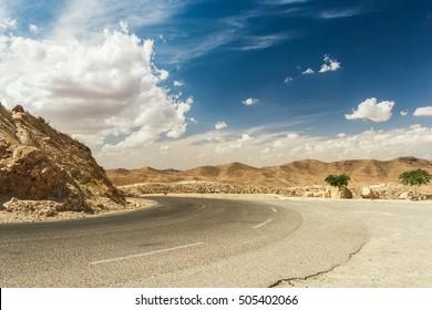 Road passes through rocky Sahara desert, Tunisia