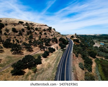 Road passing by a rock formation