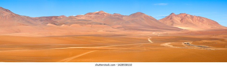 Road and paths in the Altiplano at an altitude of 4600m, Atacama desert, Chile, South America