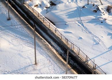 A road at a polar short winter day.