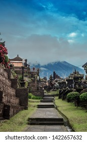 Road to Pura Agung Besakih temple by blue sky. Summer landscape with religious building pura basuki puseh jagat and mount Agung on Bali, Indonesia