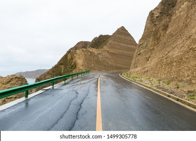 road in rain, near longyangxia reservoir,qinghai province, China