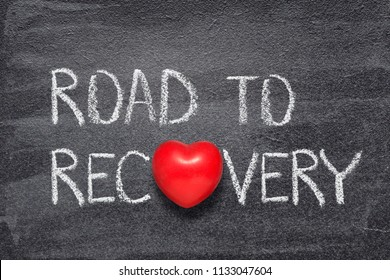 road to recovery phrase written on chalkboard with red heart symbol instead of O