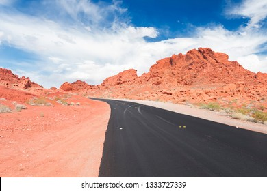 Road and red rocks in Valley of Fire State Park, Nevada, USA