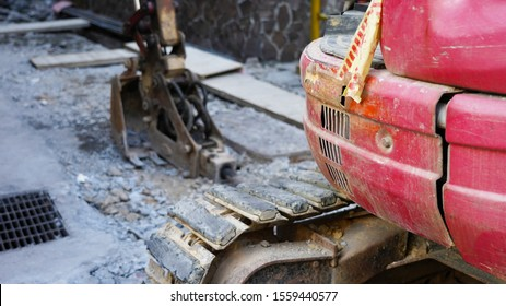 road repair equipment. hydraulic jackhammer in a road construction. Excavator with a bucket is building a new road. construction industry