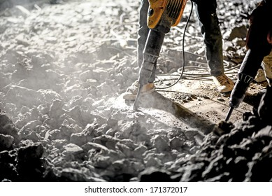 Road repairing works with jackhammer at night