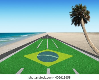 """Road to Rio de Janeiro, Brazil with Brazilian flag """"Order and Progress"""" in English and palm tree at beach"""