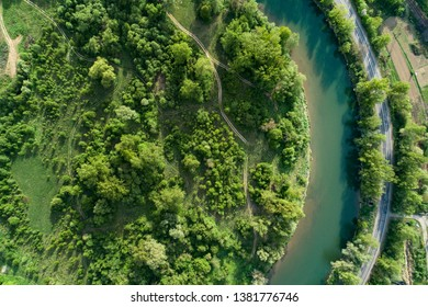 Road, river and forest aerial view. Picture taken with a drone.