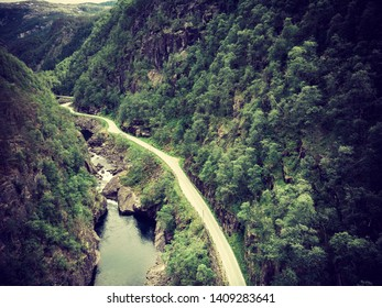 Road and river in green mountains, Norway. National tourist Ryfylke route.