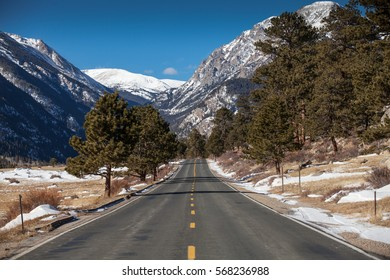 Road in the Rocky Mountain National Park in winter, USA
