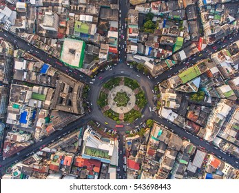 Road roundabout with car lots in the city in Thailand.Sixth Street intersection is beautiful.cityscape.Light evening.Aerial view.Top view.