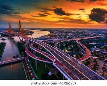 Road roundabout with car lots in Thailand.Bhumibol Bridge.