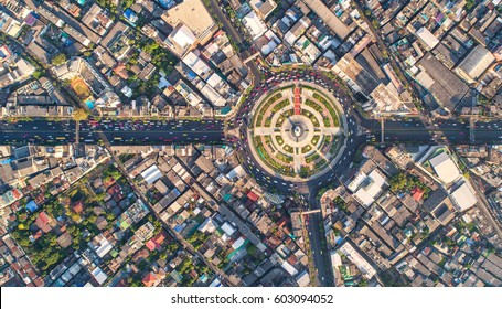 Road roundabout with car lots Wongwian Yai in Bangkok,Thailand. street large beautiful downtown at evening light.  Aerial view , Top view ,cityscape ,Rush hour traffic jam