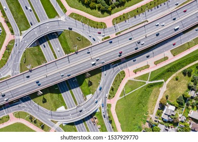 road roundabout intersection in urban residential area view from flying drone