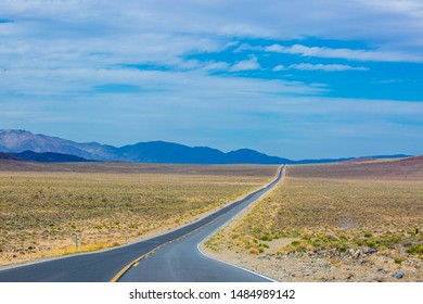 A road running through the endless scenery during summer in Death Valley National Park, California, USA