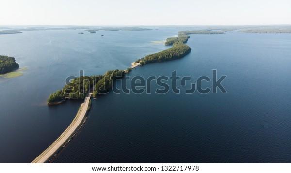 The road runs along the ridge in the wonderful scenery of Päijänne in the summer