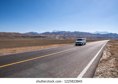 A road runs in the Death Valley National Park California USA. Motorhome on the road