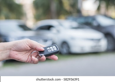 Road safety and car parking service business concept with people giving car key in parking lot