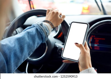 Road safety concept. Woman using smartphone while driving