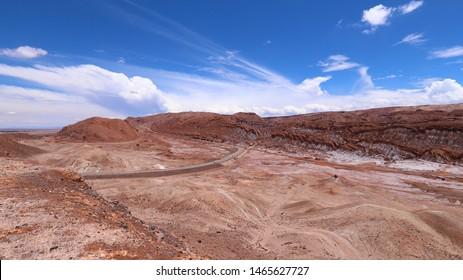 The road from San Pedro de Atacama to Calama. View of the landscape of the Atacama Desert. The rocks of the Mars Valley (Valle de Marte) and Cordillera de la Sal, Atacama Desert, Chile