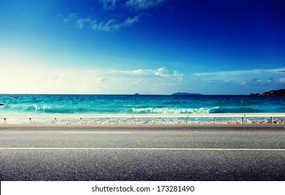 road and sea in sunset time