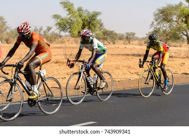 ROAD IN SENEGAL - APR 24, 2017: Unidentified cyclists during a race on the road in Senegal