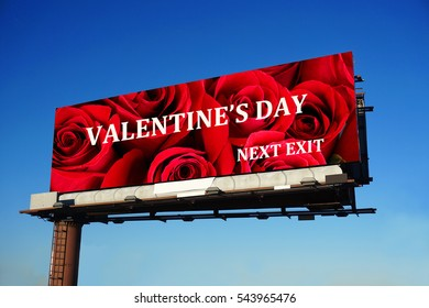 road side billboard with valentine day text and rose background in blue sky