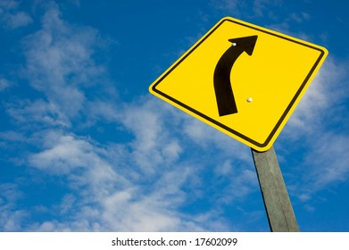 road sign against a blue sky with clipping path.