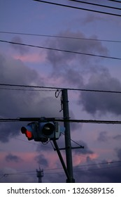 The road sign against the purple sky