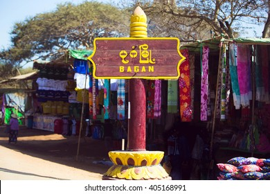 "Road sign ""Bagan"" in front of the market"