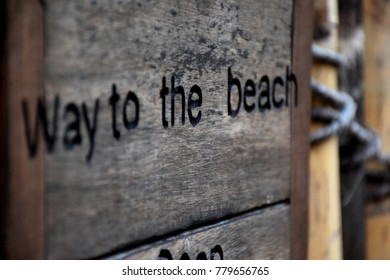 Road sign to beach