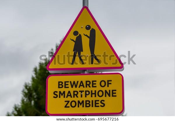 Road sign - beware of smartphone zombies
