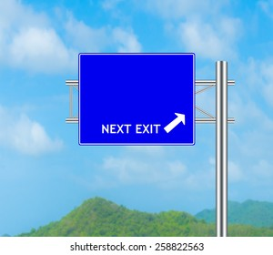 Road Sign concept Next Exit and Sky background.