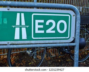 Road sign directing to the Highway E20 cross north Europe