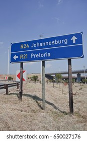 Road sign directions by car from or Tambo airport to Johannesburg and Pretoria. South Africa,