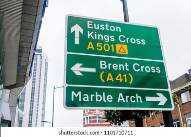 Road sign for Euston, Kings Cross, Brent Cross and Marble Arch areas of London, England