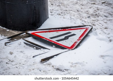 Road Sign Fallen Over in the Snow