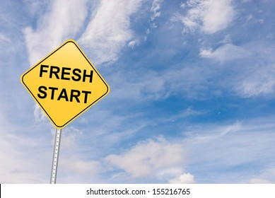 road sign with a fresh start message