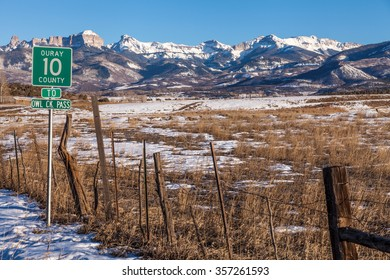 Road sign in front of mountain peaks near Ridgway, Colorado