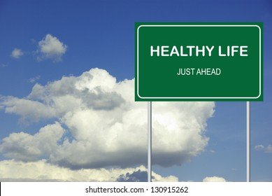 Road sign to healthy life cloudy sky background
