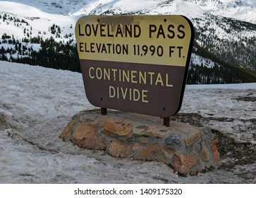 Road sign for high altitude Loveland Pass located close to many hiking trails for 13ers and 14ers in the Rocky Mountains not far from Denver Colorado