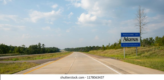 The road sign indicates you are entering Arkansas the natural state